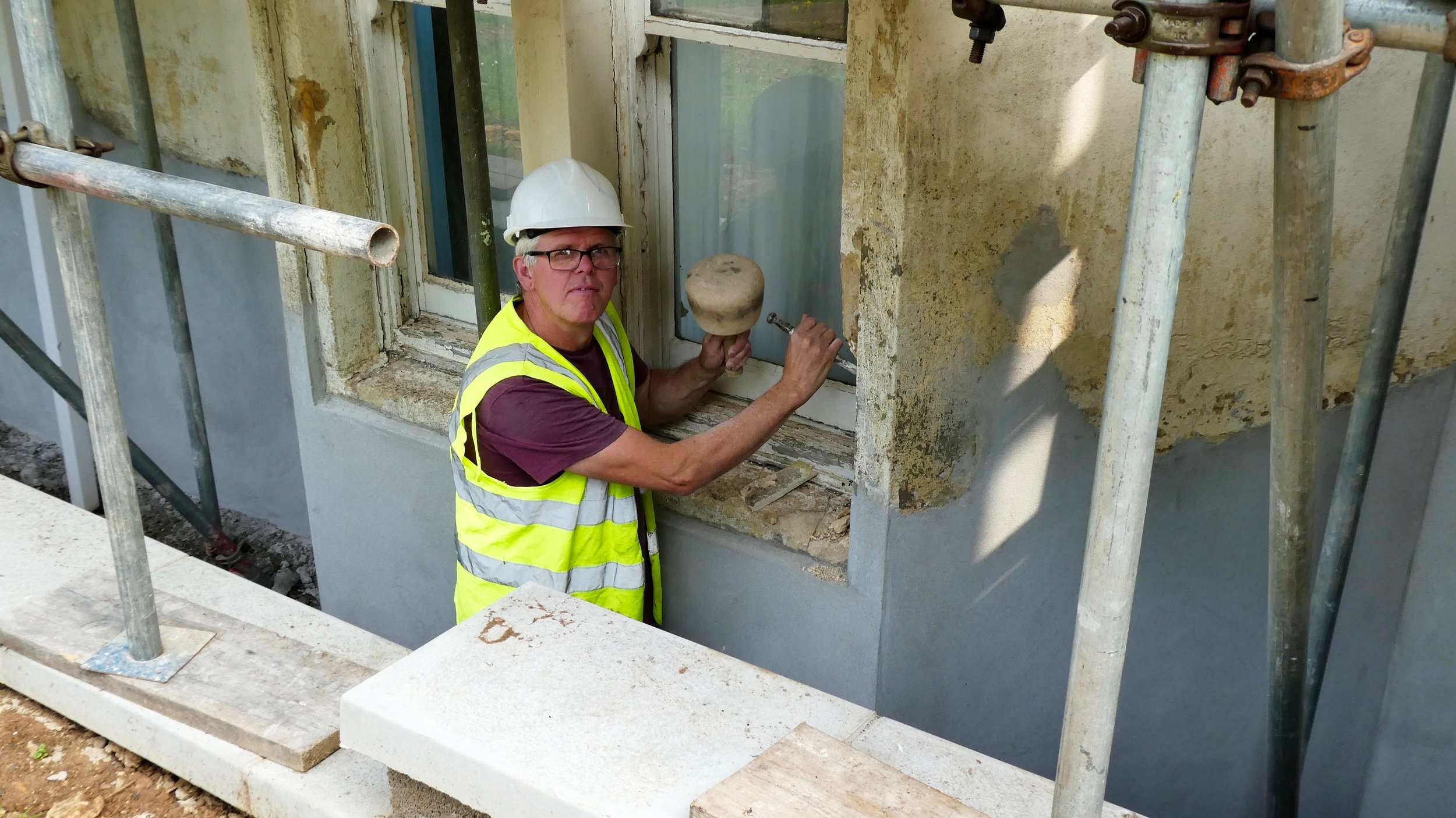 Andrew Cooper, Master Stonemason, begins the restoration of Andrew House.