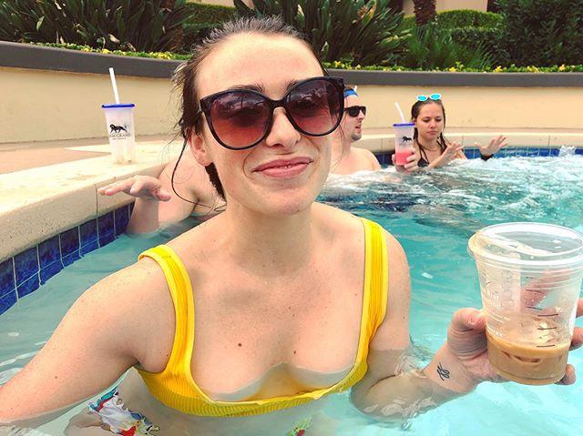 Yes, I'm in a hot tub. Yes, that's iced coffee in my hand.