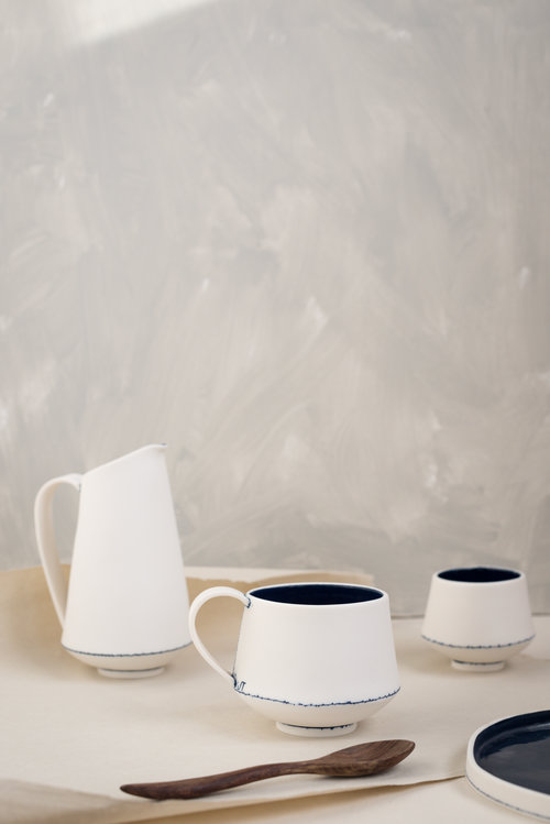 Jessica Thorn  A passion for both cooking and eating has naturally influence Jessica's functional response within her designs. She is charmed with the simplistic design of tin and enamelware and aims to encapsulate and reminisce vintage kitchenware through her contemporary designs.