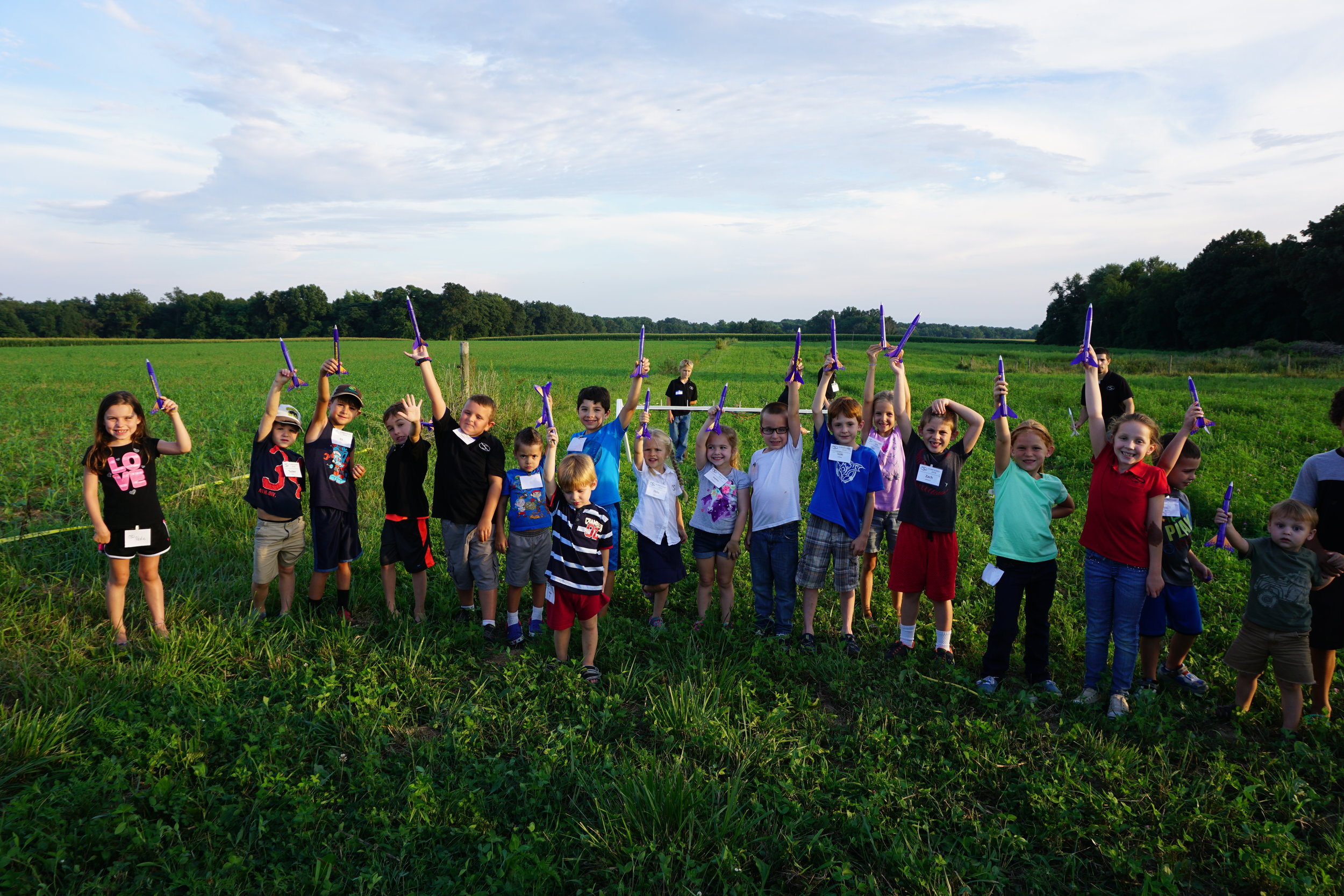 kids holding rockets up high.JPG