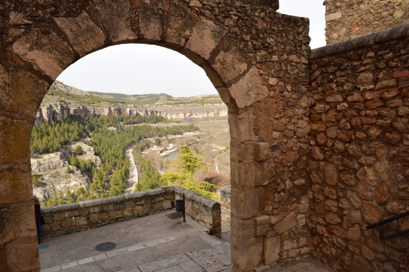 Walking along the wall you will discover original arches such as this one with a spectacultarview of the valley below.