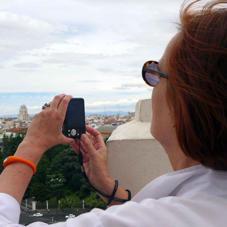Patricia Harris taking a picture from the Mirador Madrid on the 7th floor of the Palacio de Cibeles.
