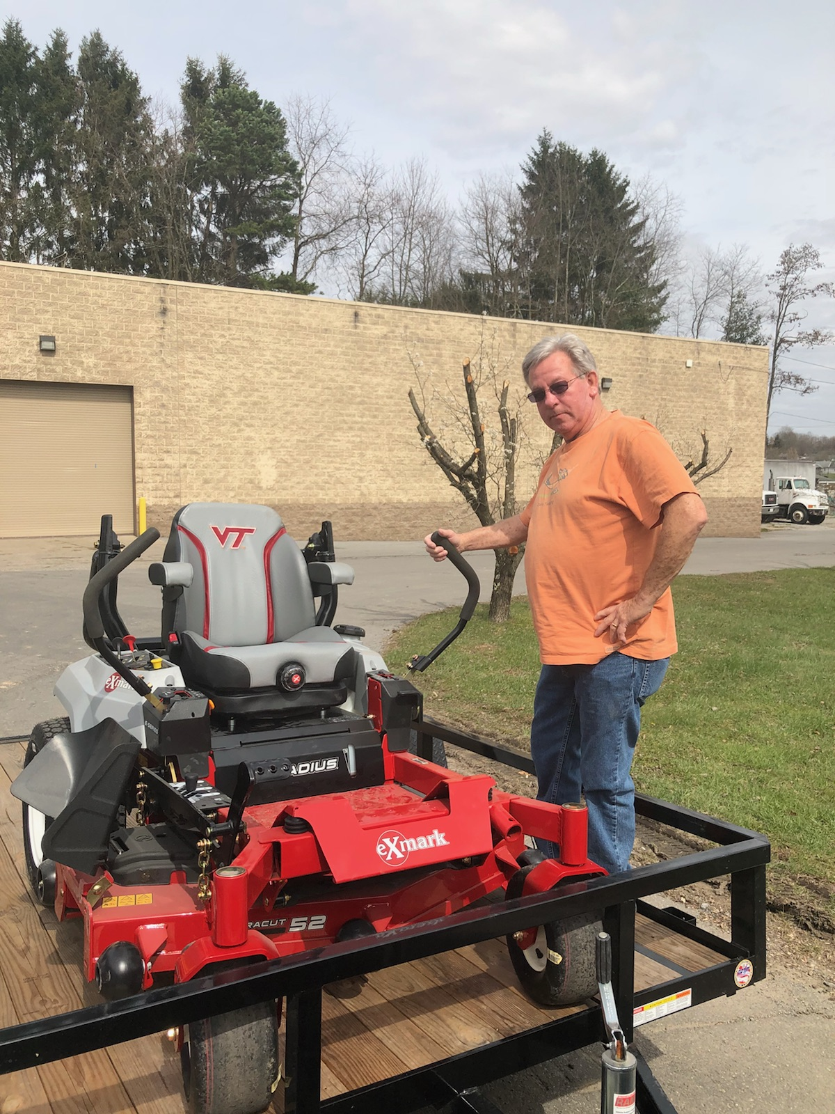 Gary Lawson - with his new eXmark Radius E-Series with a Virginia Tech collegiate seat! Call today!