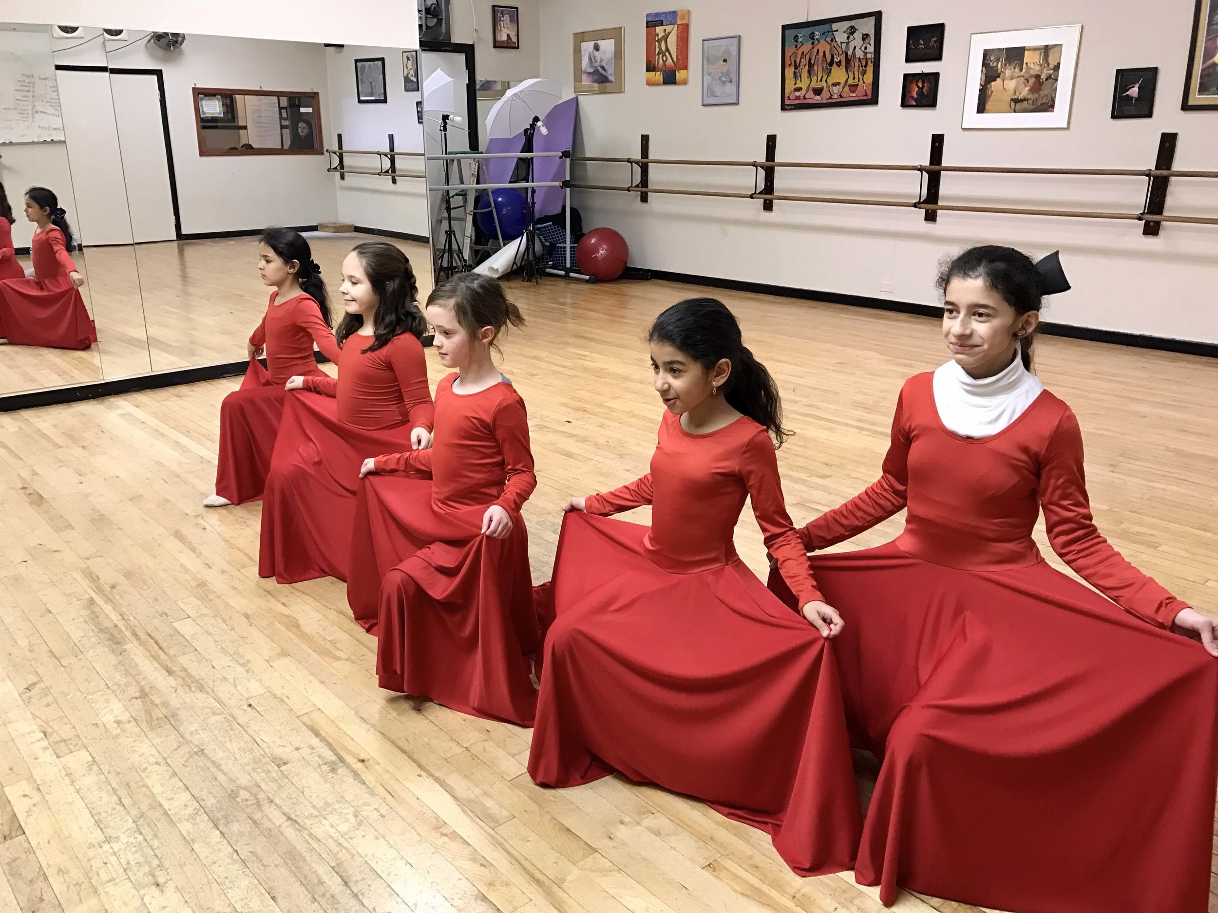 Dance Peace holding skirts