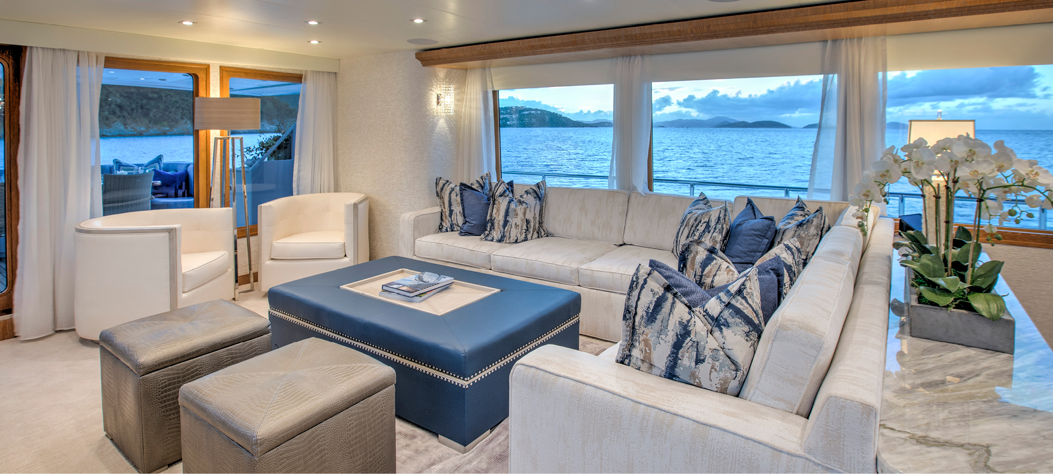Yacht refit for M/Y WINNING HAND featuring custom-made pieces with storage in all salon furniture, coffee table with opening lid that provides access to hidden storage plus ottomans and sectional sofa al including additional storage.