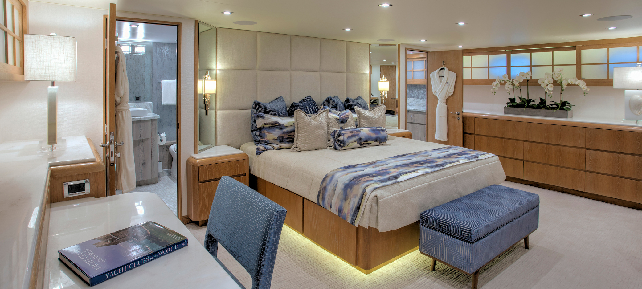 Yacht makeover and refit featuring master cabin design with bed base created with a hydraulic lift to provide convenient access to huge hidden storage underneath. Shoji screens at the windows also have hidden storage behind them, practical for soft luggage and duvets.
