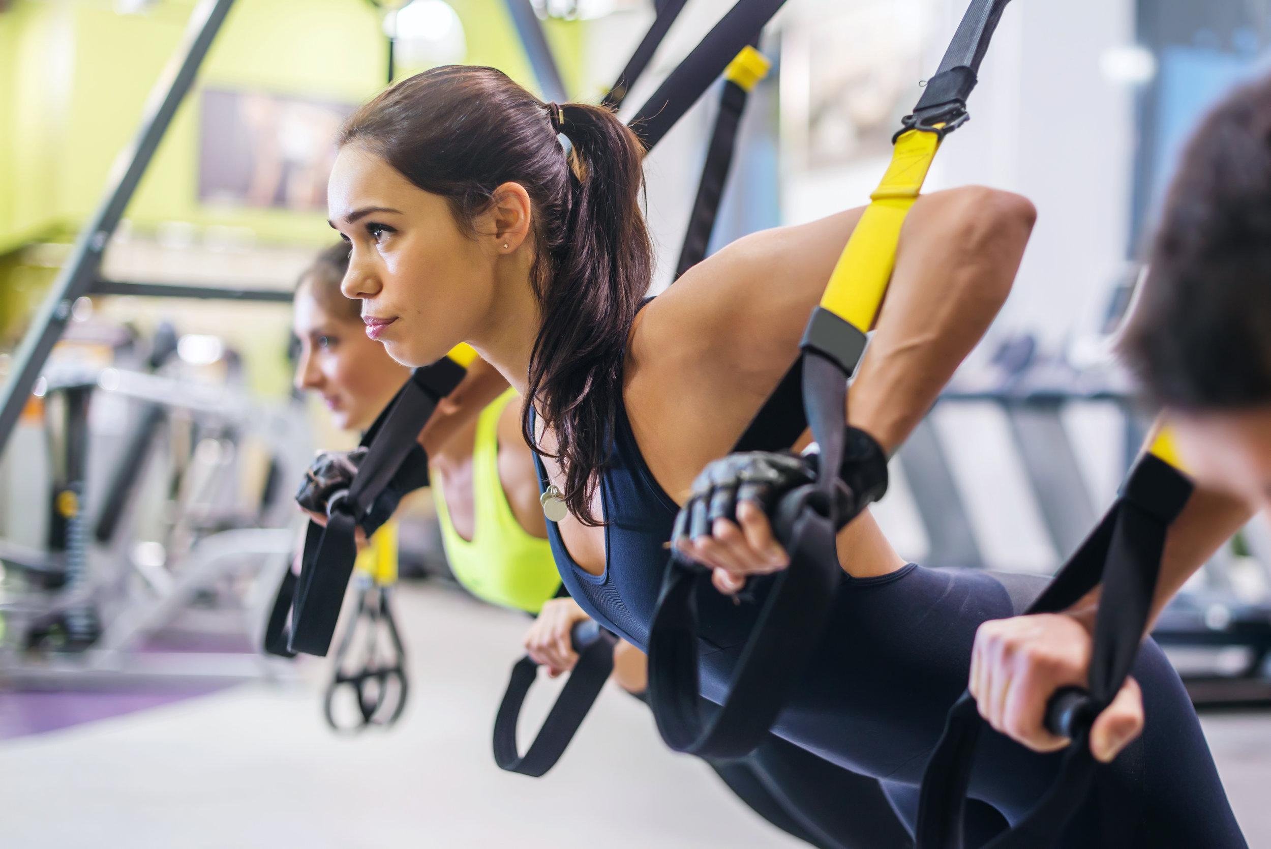 bigstock-Women-doing-push-ups-training--109099061.jpg