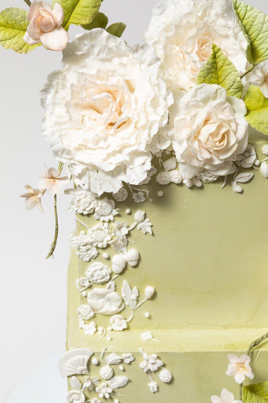Sage Buttercream Bas Relief Peony Offset Square Wedding Cake