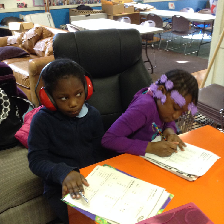 Kids doing homework at after school tutoring