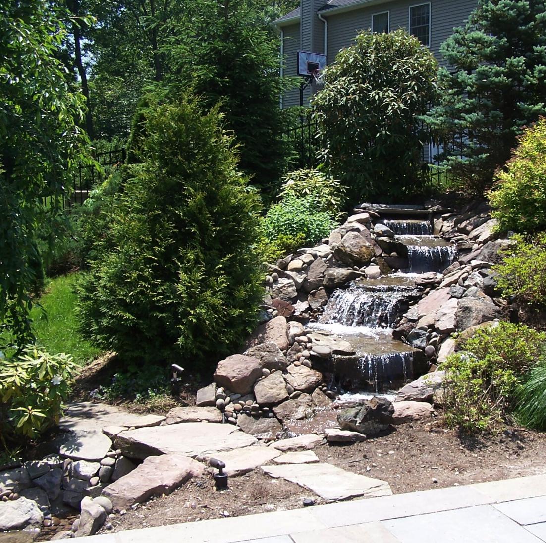 Westchester County, NY custom masonry design steps water fountain