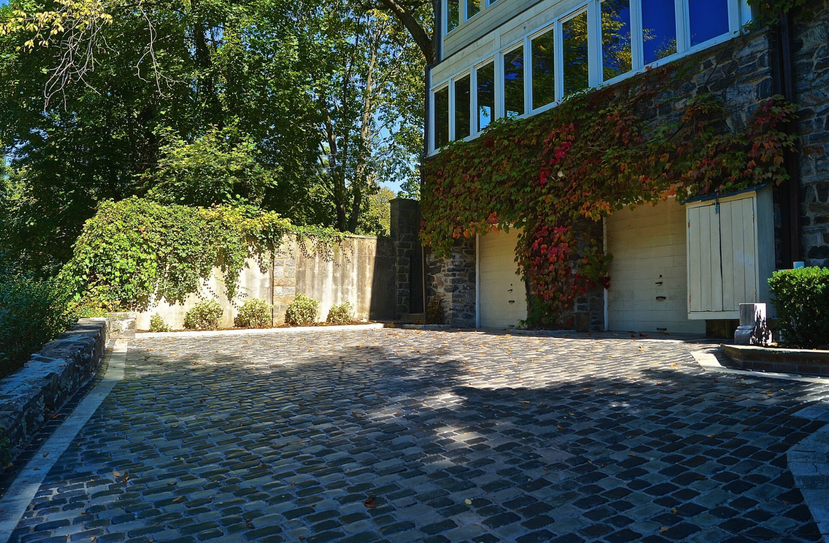 Westchester County, NY natural stone retaining wall and steps and patio and driveway