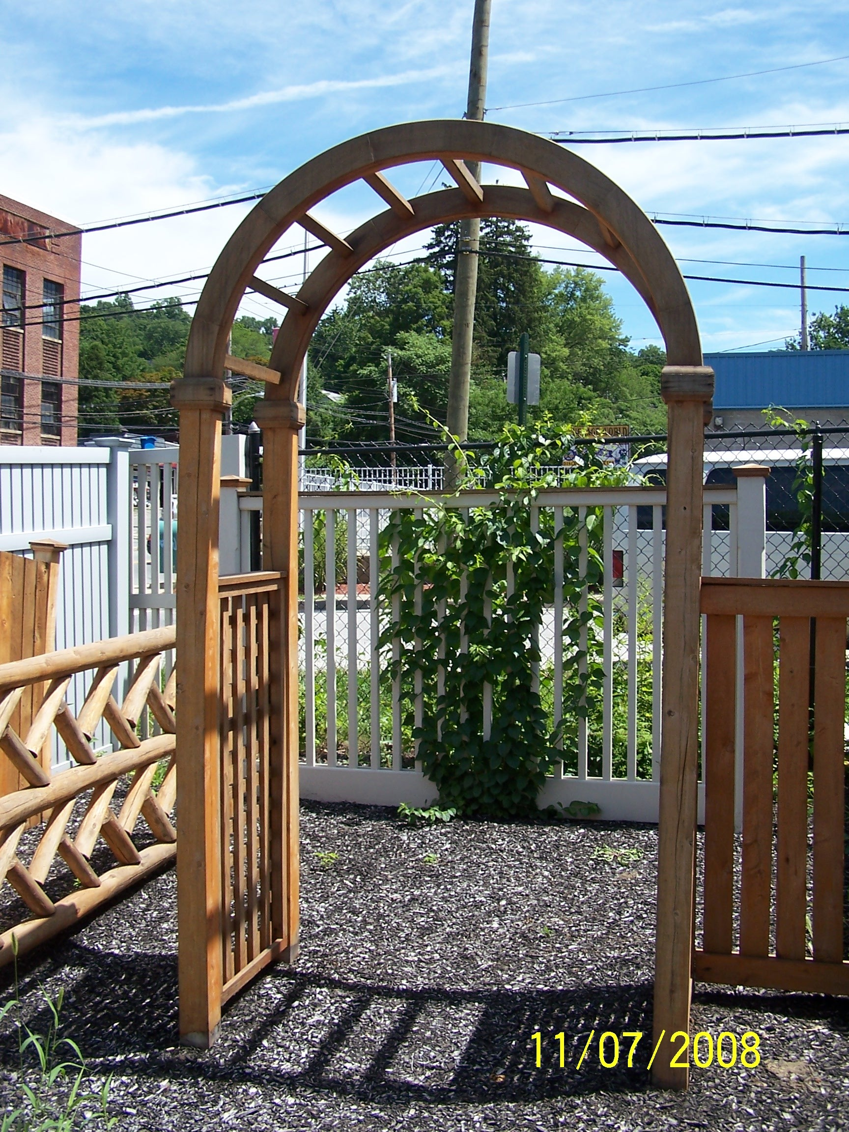 Professional landscape design with fence installation in Croton-on-Hudson, NY