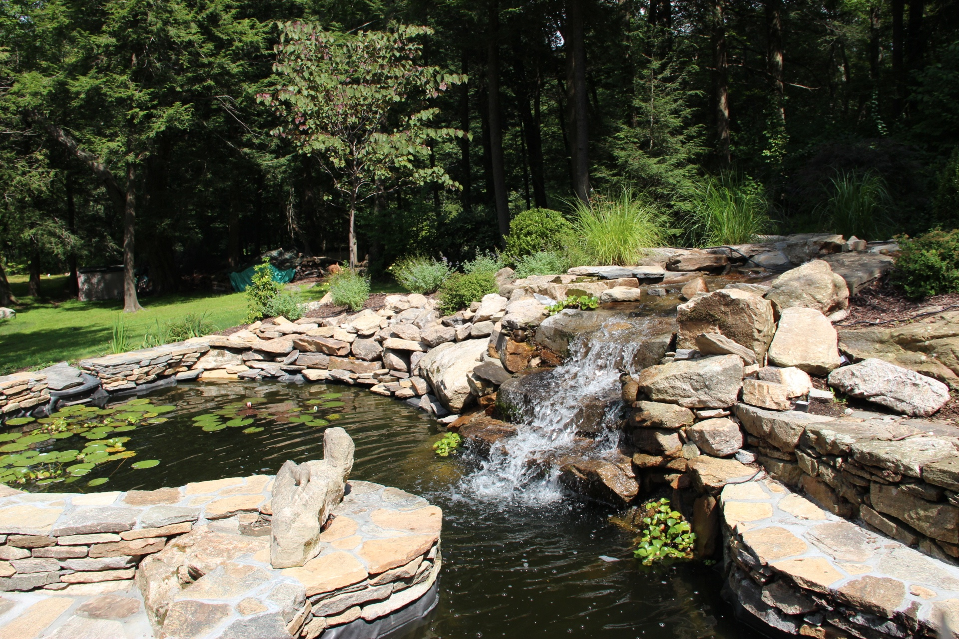 Professional landscape design with water feature in Croton-on-Hudson, NY