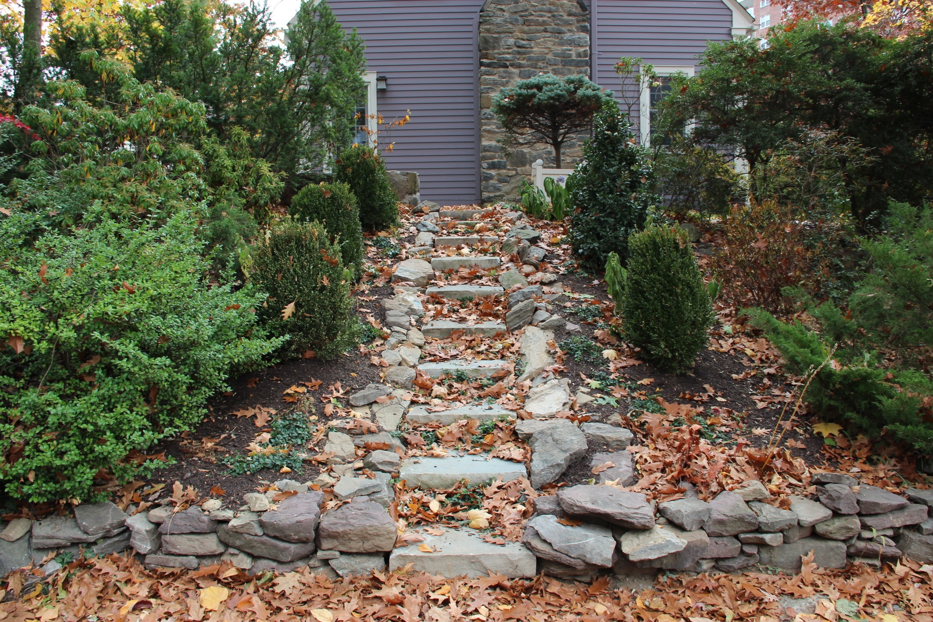 Professional landscape design with stone steps in Chappaqua, NY