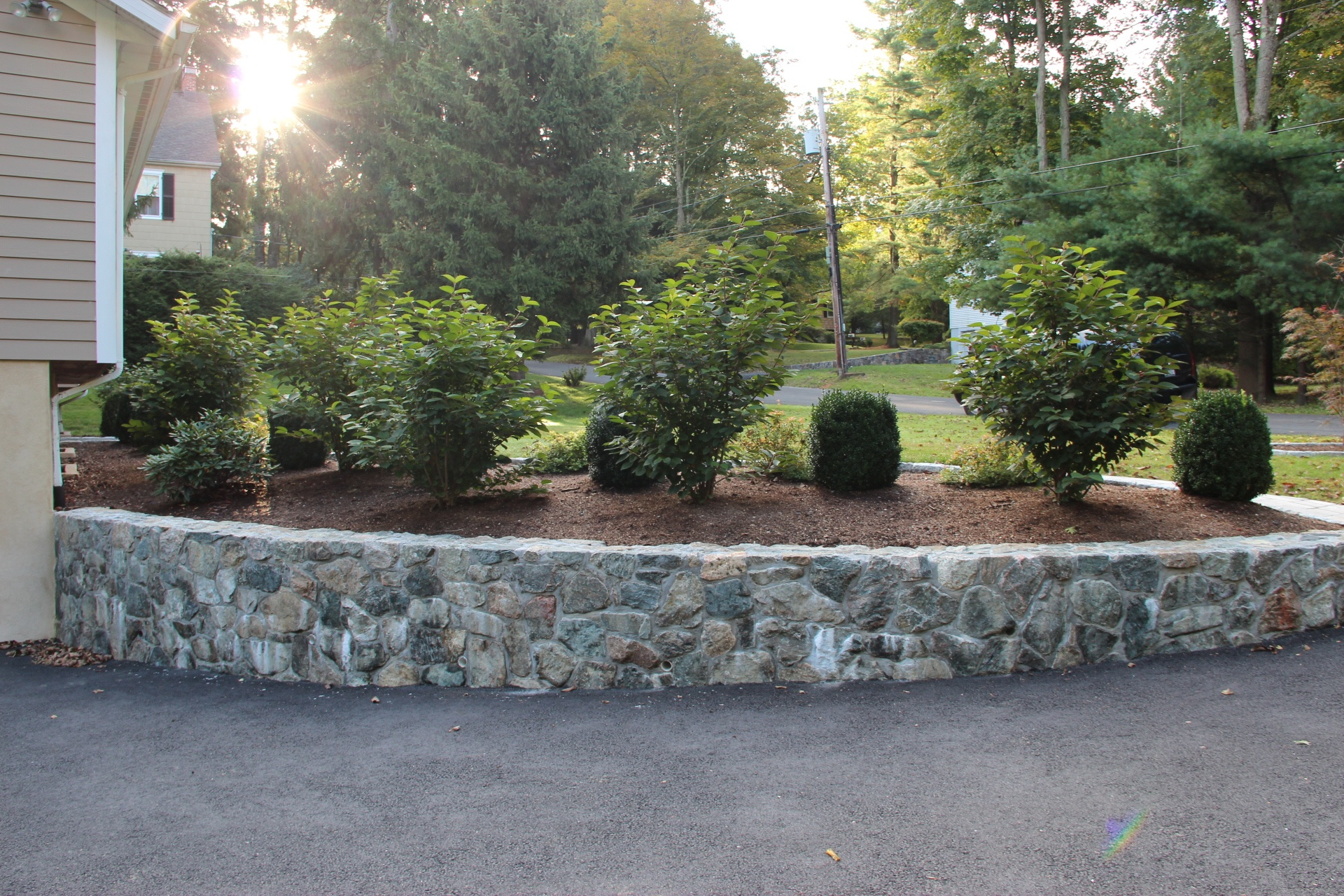 Top landscape design with retaining wall in Millwood, NY