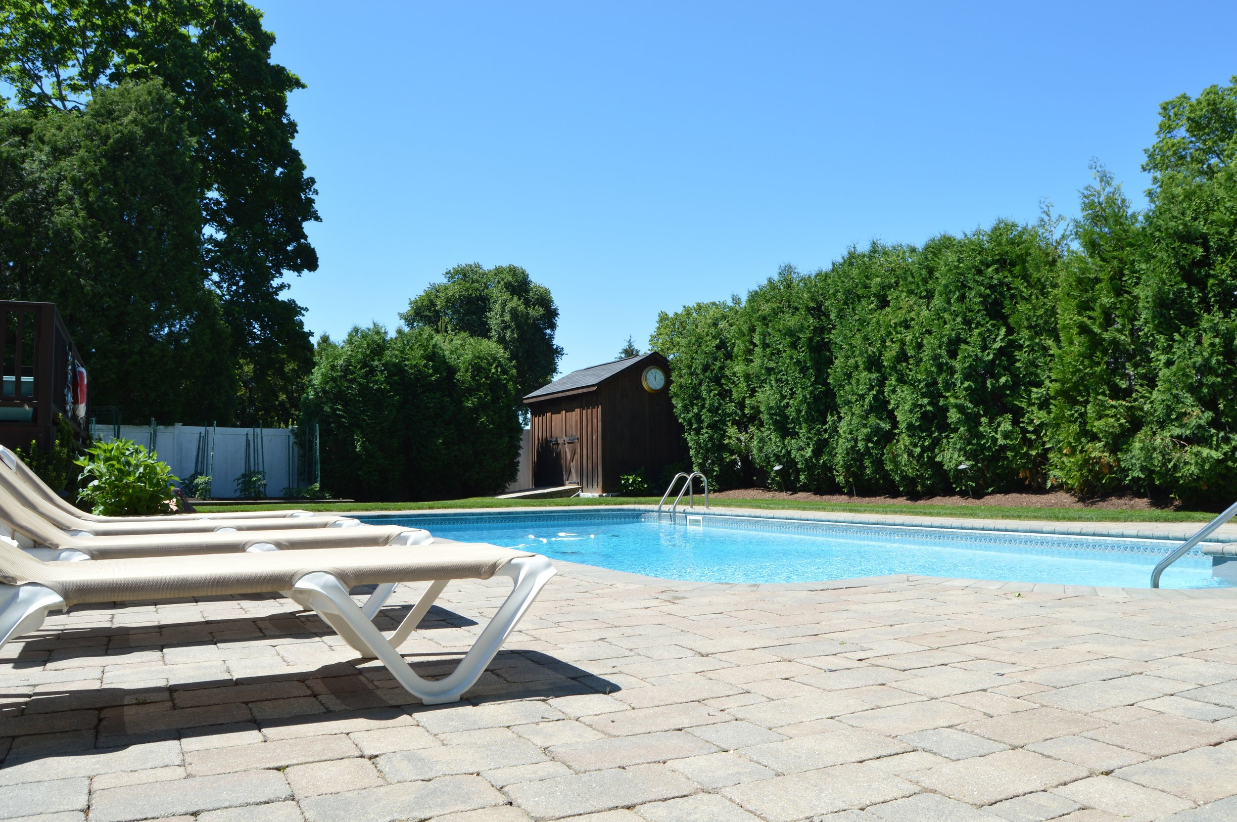 Professional landscape design with pool deck in Chappaqua, NY