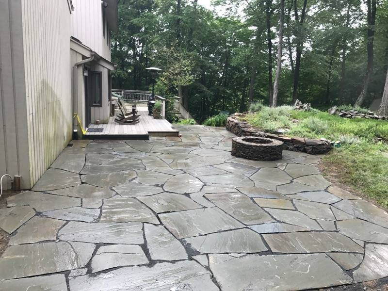 Patio installation in Cortland Manor NY with outdoor fireplace