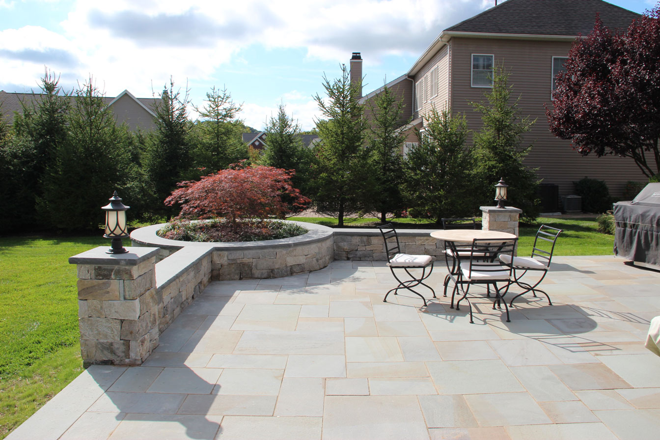 Concrete pavers and segmental retaining walls