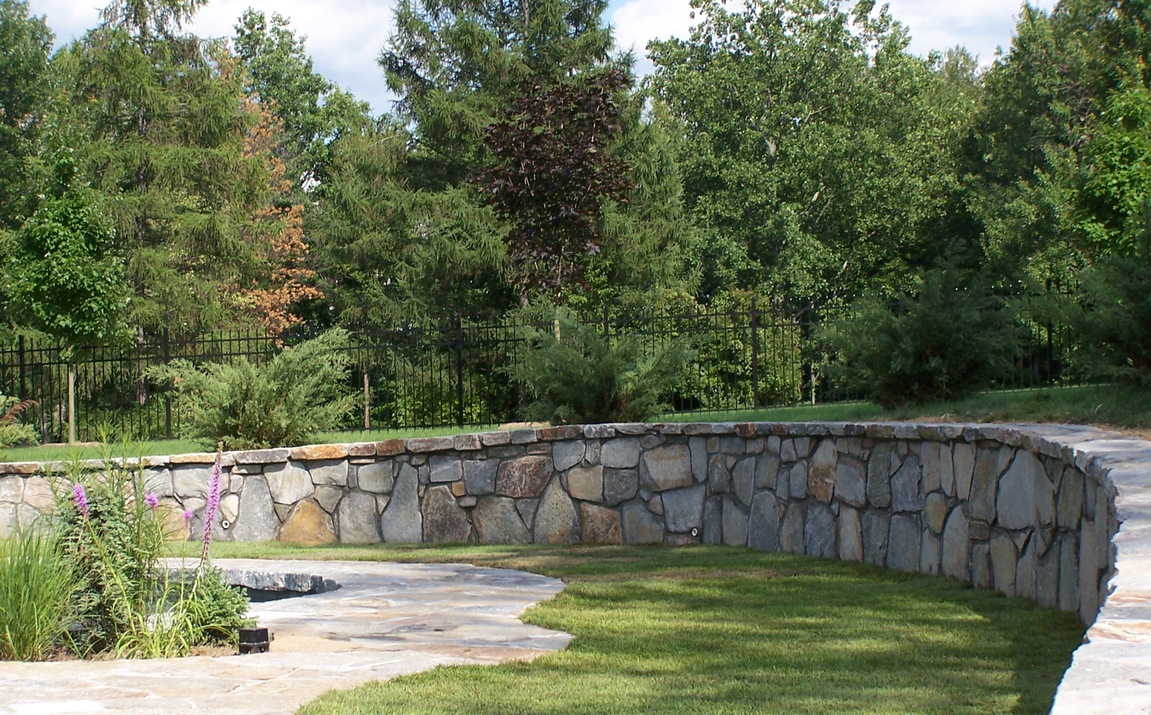Landscape Construction Tips for Creating Curved Retaining Walls in Peekskill, NY