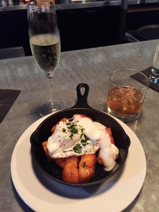 Potatoes bravas with egg and aioli sauce.