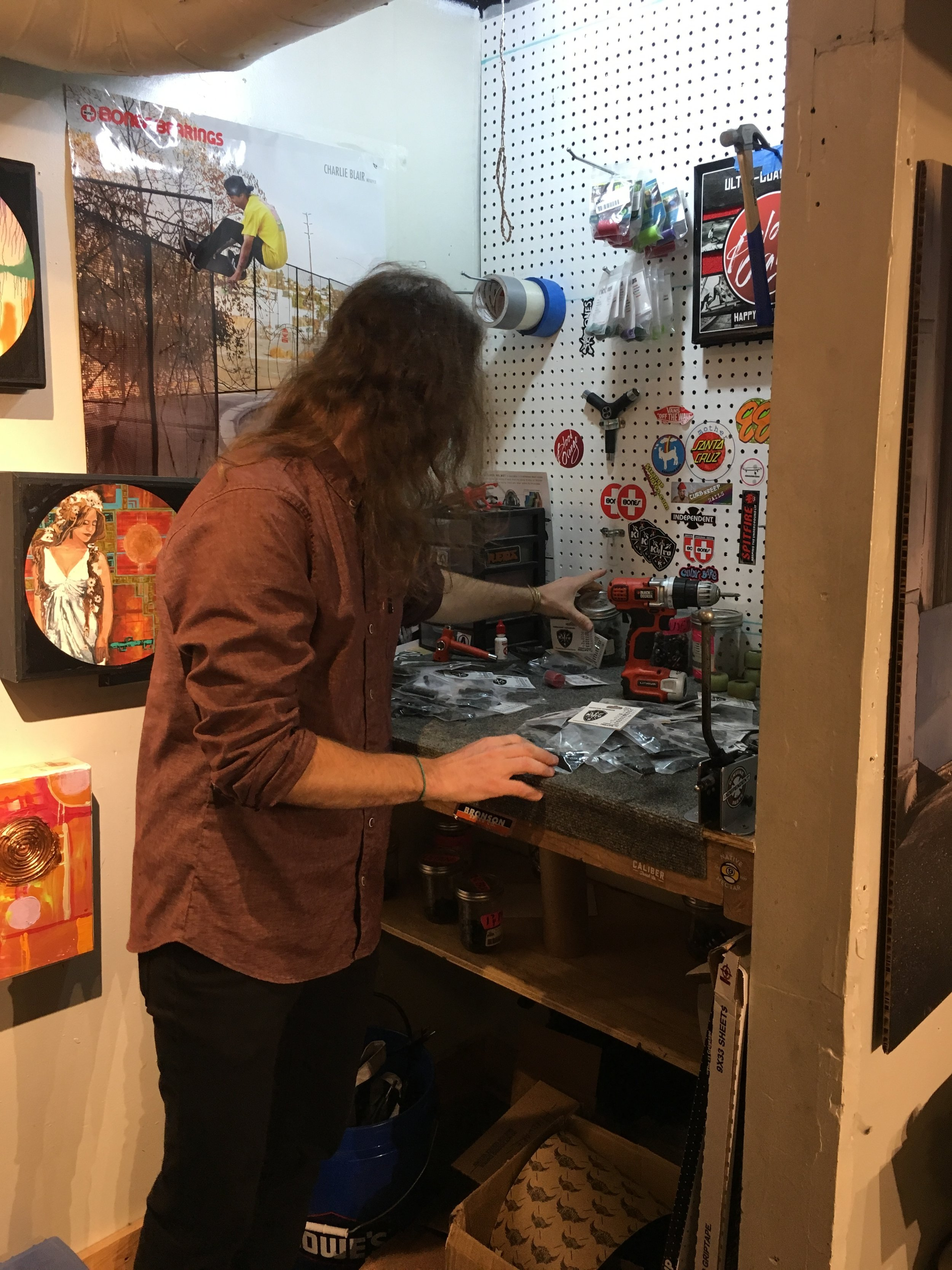 Matt Miller, organizes through newly arrived skateboard product,  Riser Pads  in the back of his shop Friday, Apr. 21, 2017. Custumers have the option to place  Riser Pads  on their skateboard if they desire.