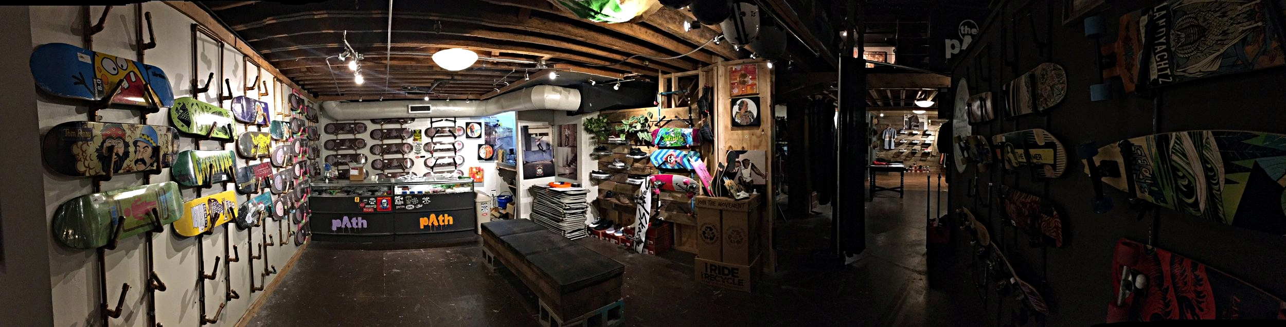 Path Outfitters skateboard shop, 21 West Mountain St Fayetteville, AR. Friday, Apr. 21 2017. Numerous professional and locally made skateboards sit on display, along with skate shoes and professional longboards.