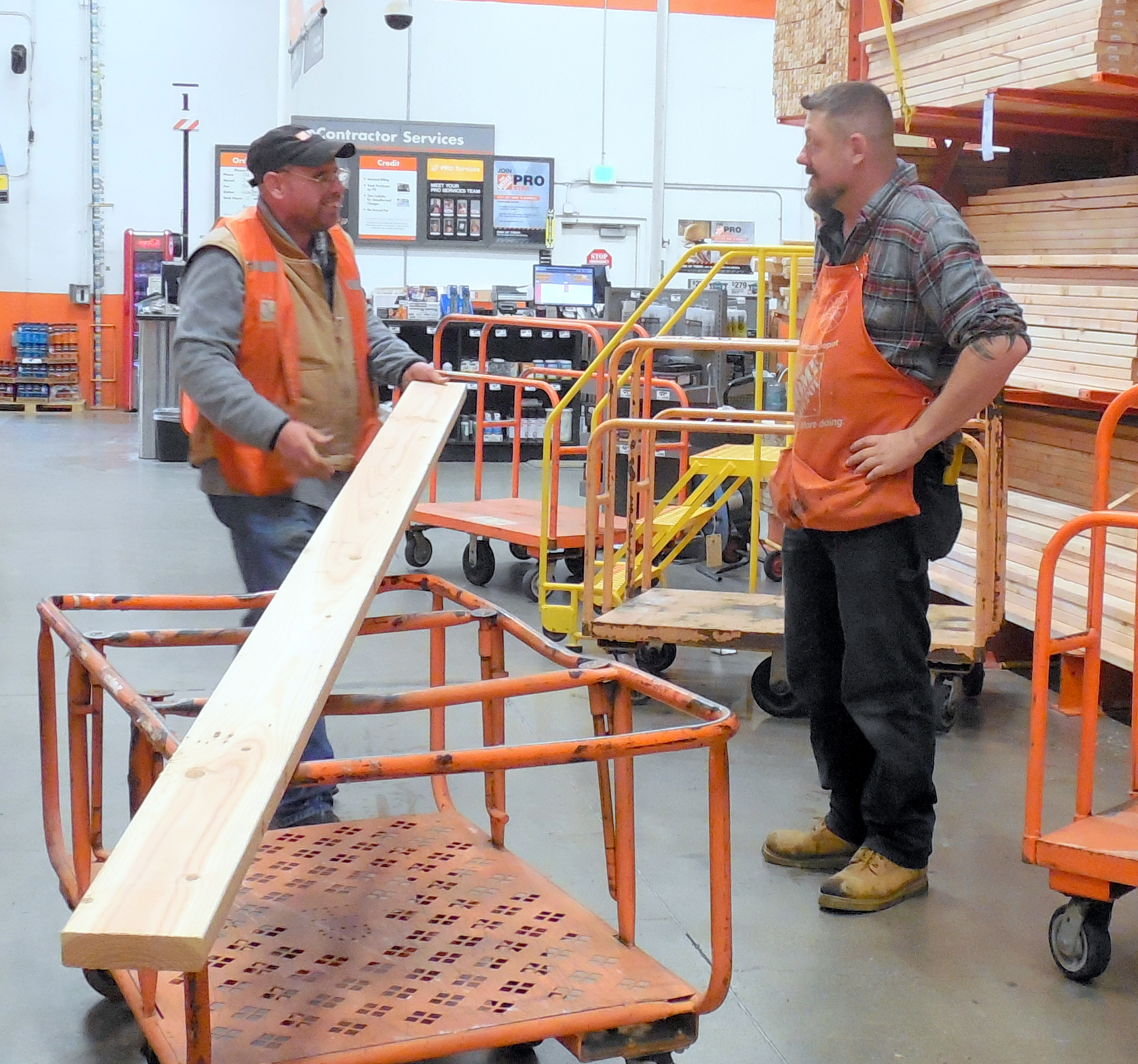 38 Home Depot-Jimmy loading lumber with Co-worker.jpg