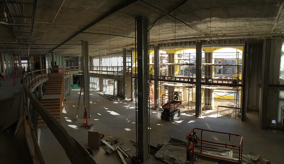 Level 1 view of dining room and courtyard from mezzanine corridor