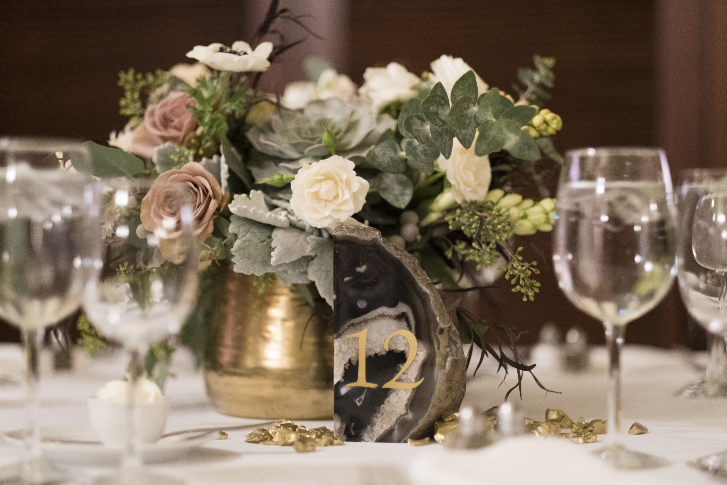 The bride had a clear vision for the elegant decor using crystals, agate, and mixed metals to create an opulent yet warm atmosphere.