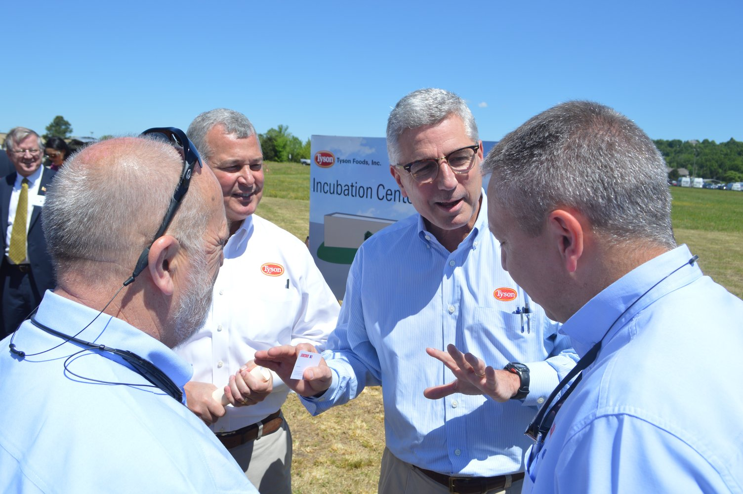 Tyson Foods President and CEO Donnie Smith talks with Noel White, the company's president of poultry, and two employees of Jamesway, a company that will be involved in the Tyson Foods Incubator Center project in Springdale. Tyson Foods earlier today held a ground breaking ceremony to kick off the center's construction.