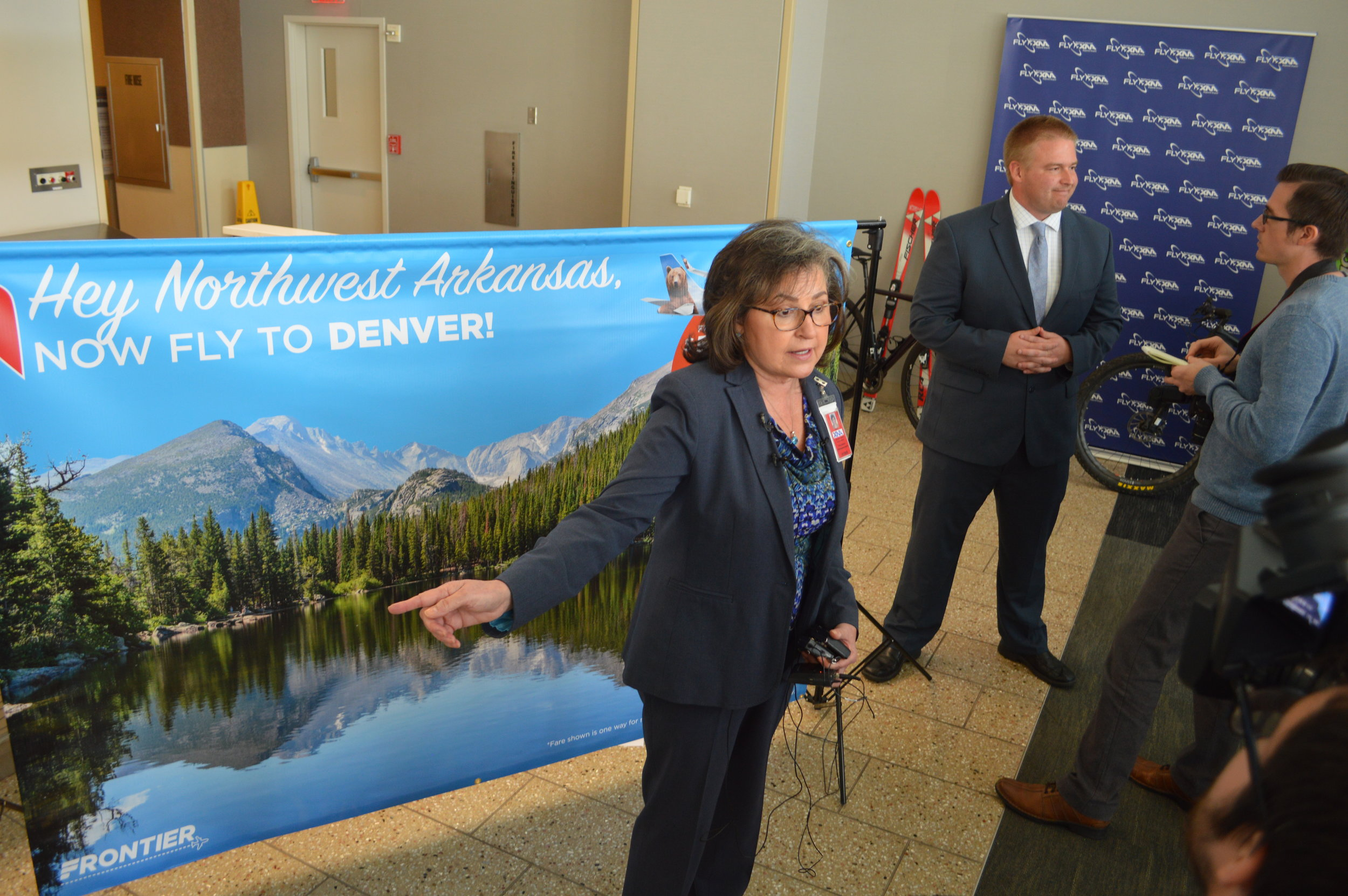 Kelly Johnson of the Northwest Arkansas Regional Airport and Jonathon Nield of Frontier Airlines answer reporters' question about the airline's start of flights from the airport to Denver. The first Frontier flight between the communities takes place June 27.