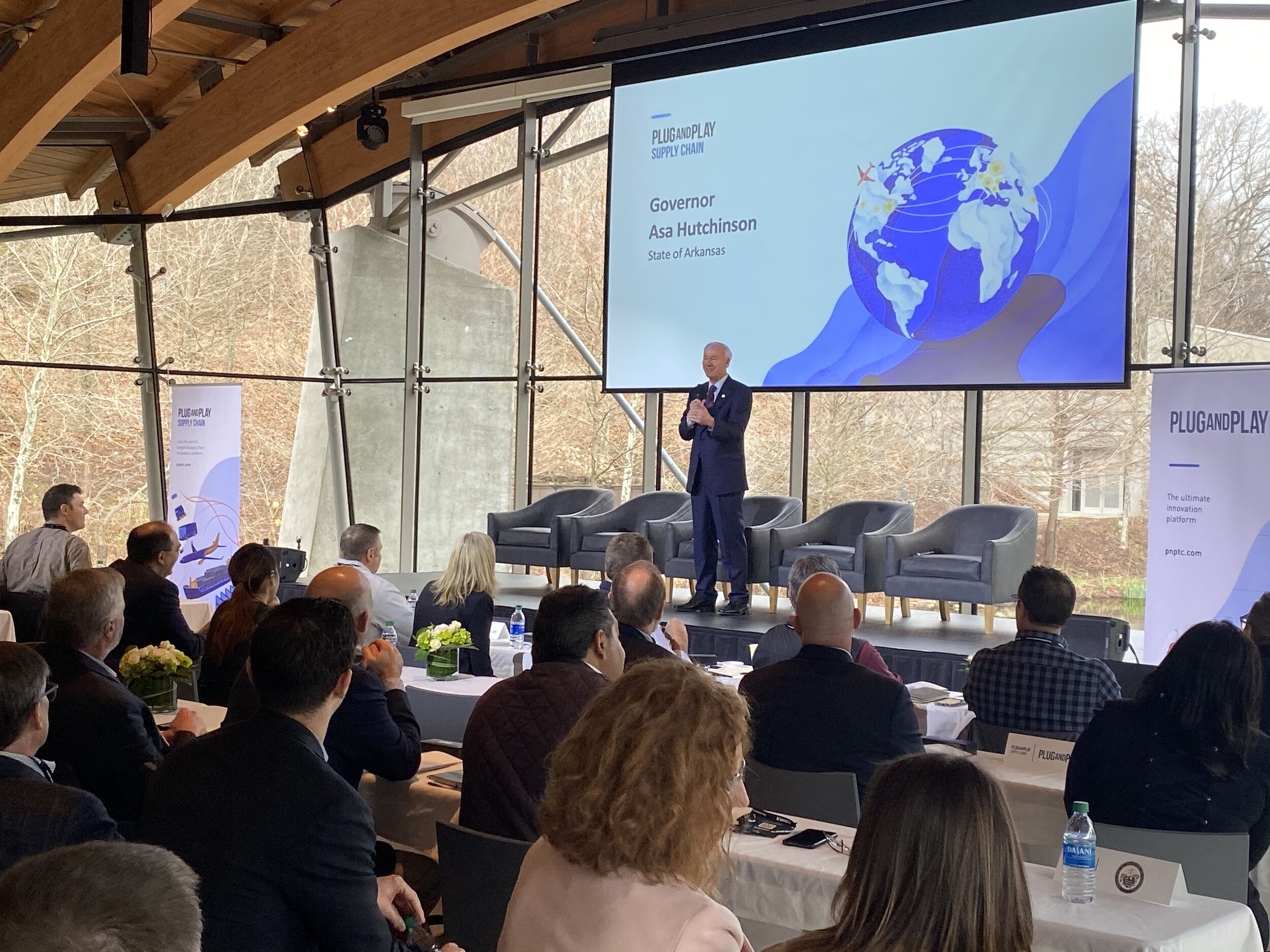 Gov. Asa Hutchinson addresses the crowd of the more than 200 attendees at the Plug and Play Batch 1 Summit on Jan. 31 at Crystal Bridges. Hutchinson later met with several of the company founders who have expressed interest in opening offices in the state.