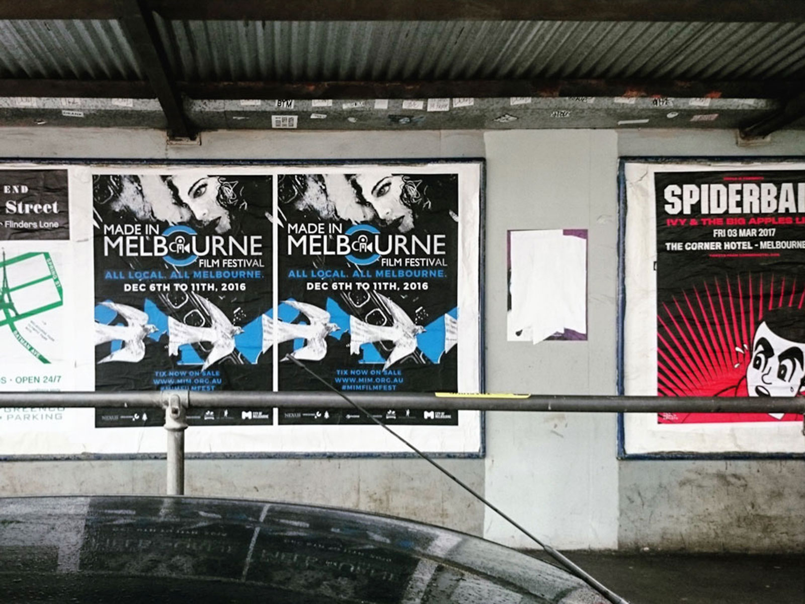 MIMFF poster illustration at Richmond Station, next to the Spiderbait poster.