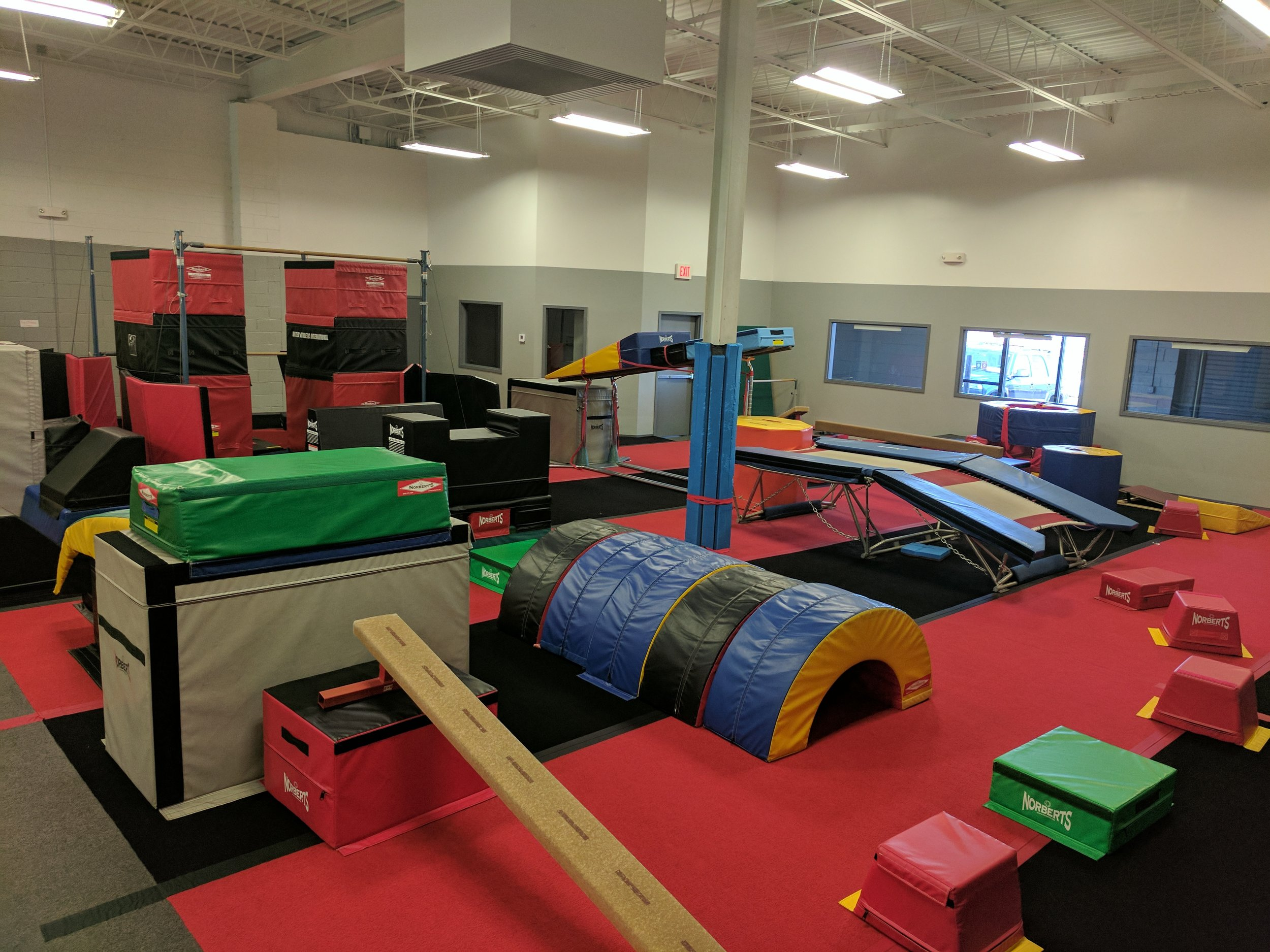(Lower Gym partial overview) Obstacle courses including spider crawl and double-mini trampoline