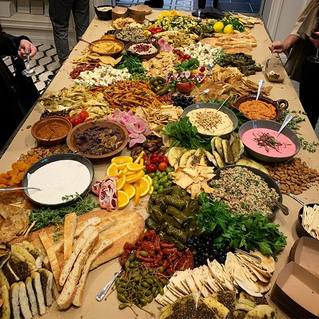 Mezze madness today! We absolutely love creating grazing tables- so many colors, flavors, and textures 😍  #grazingtable #mezze #mediterraneanfood #vegetarian #partyfood #losangelescaterer #beverlyhillscaterer #hummus #tabouli #muhamarra #babaghanoush #zaatar #pita