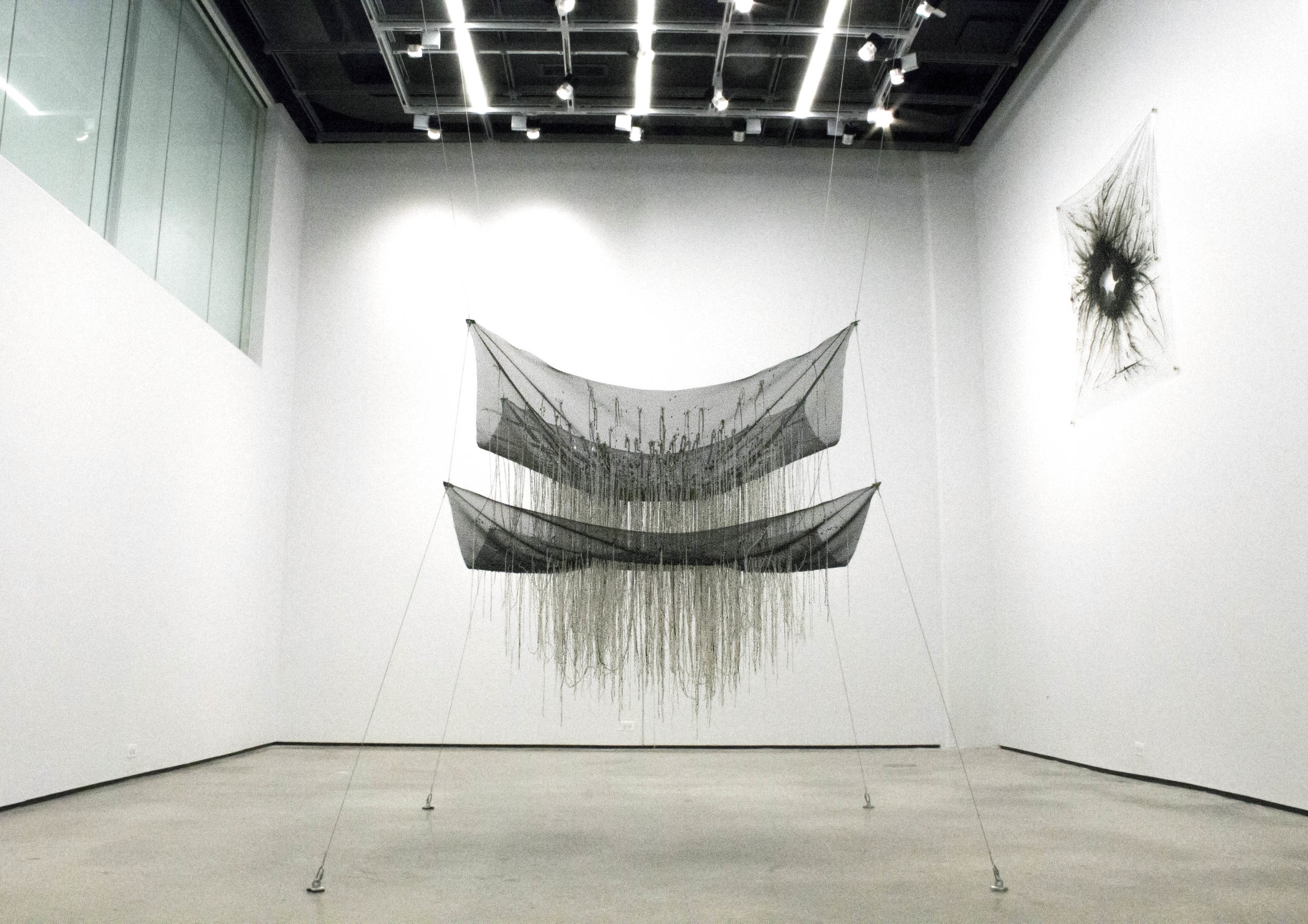 """To be a proper being"" , 2015 Cotton string, mesh, wire, clear plastic, rubber, 57"" x 72"" x 56"" (except wires)  Courtesy Kyungjin Kim & Carrie Able Gallery"