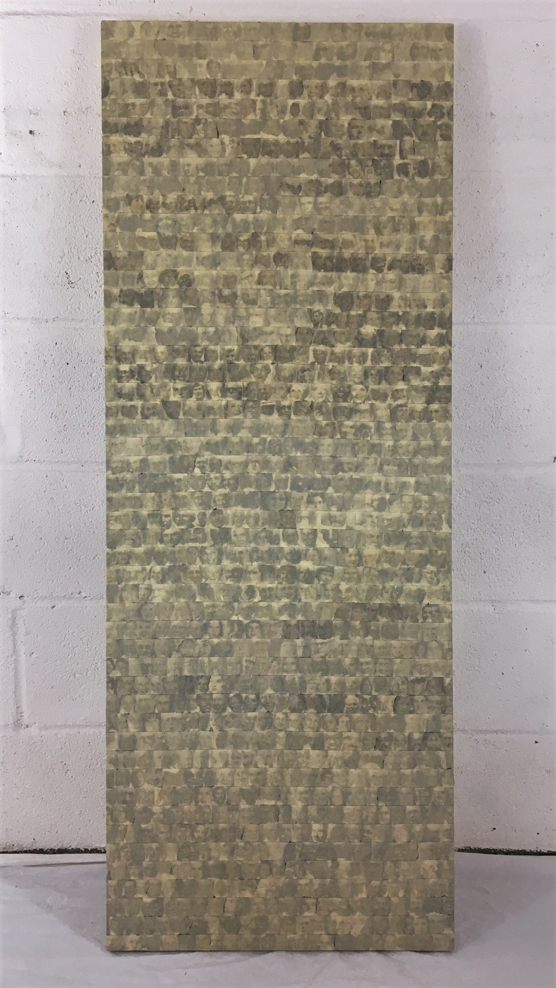 """Obits"" , 2017  Black and white faces from the obituary section lifted off newspaper with masking tape on canvas, gel medium, 12""x32""  Courtesy Travis Childers and Carrie Able Gallery"