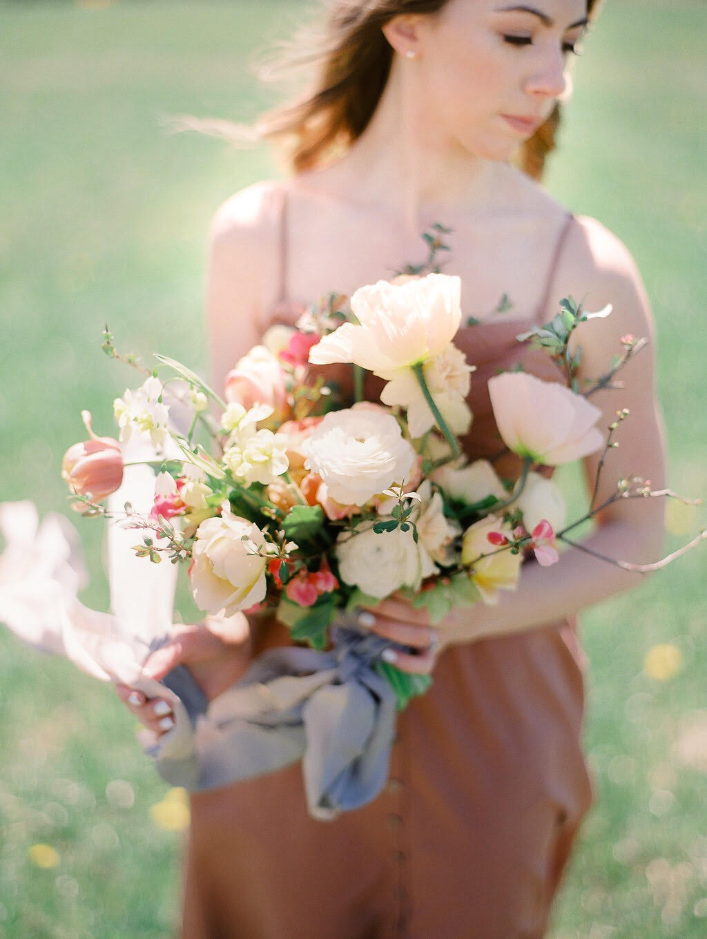 A late April bouquet with minimal 'greenery' but abundant interest. I used pink flowering quince as the base of the design. Photo by Jenny Haas.