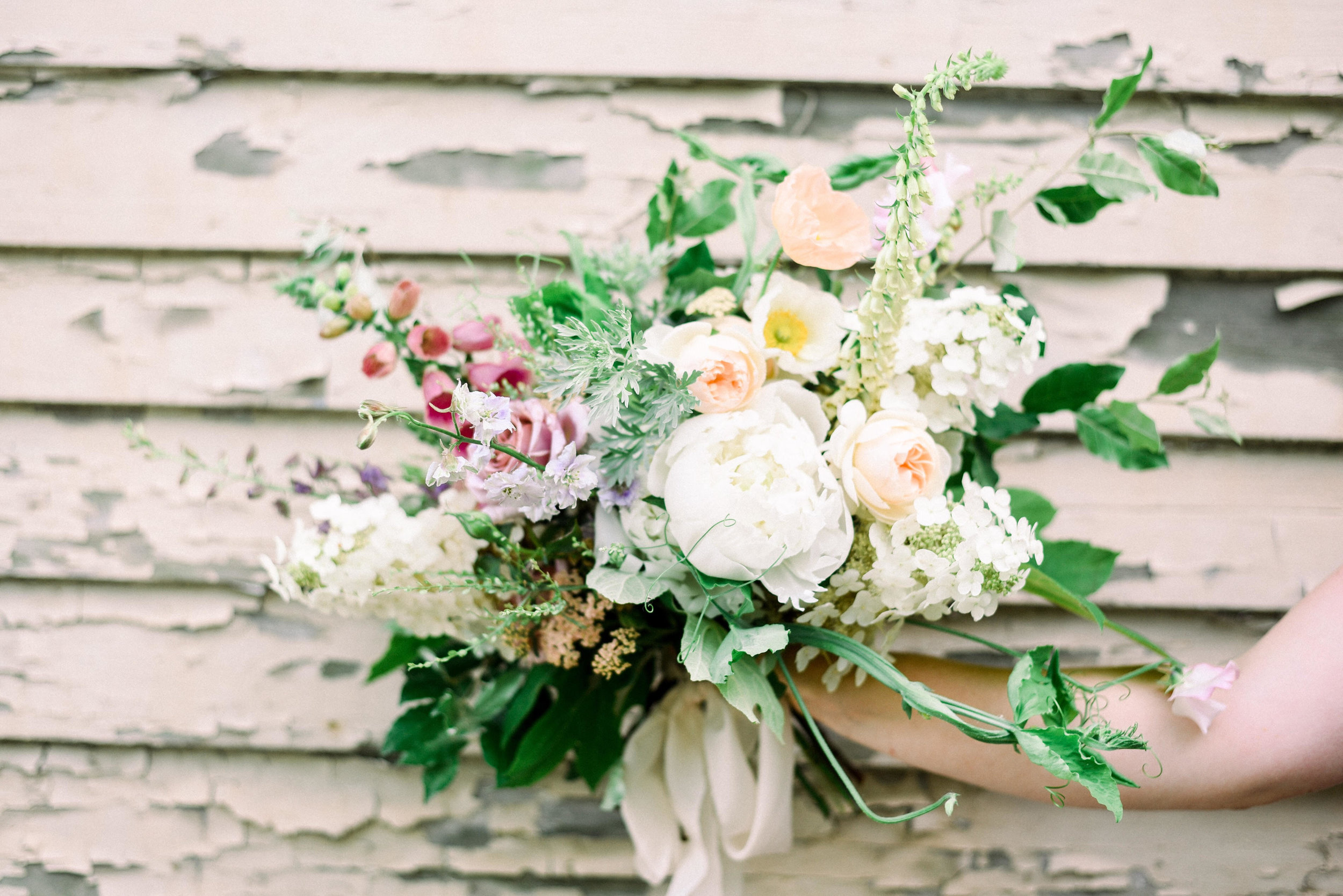 Sweet pea vines were a lovely accent to this mid-June bouquet. Photo by Henry Photographs.