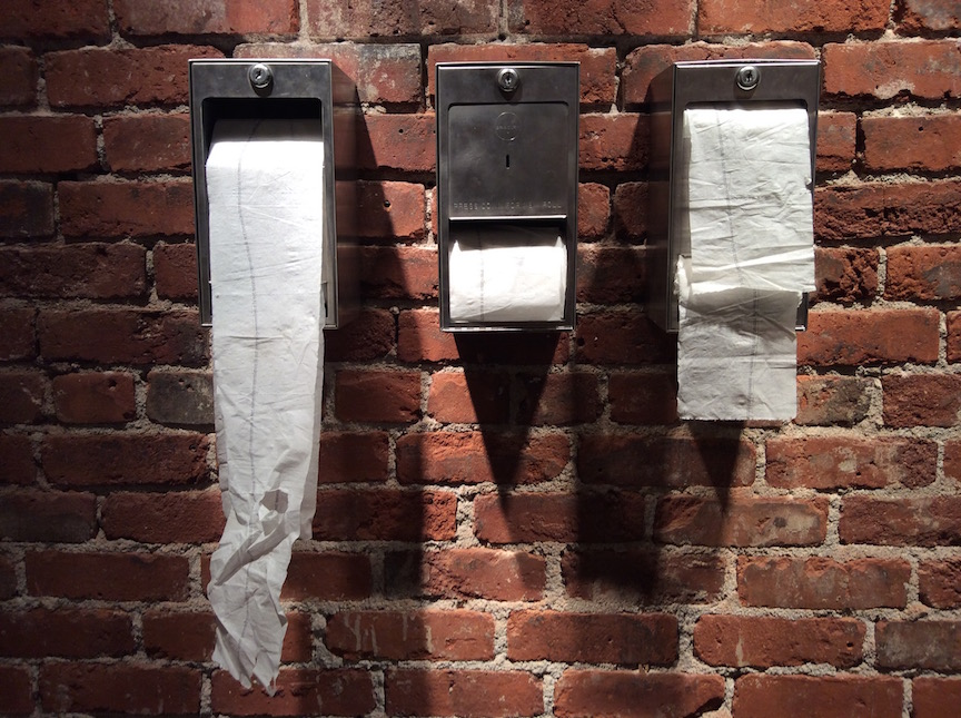 Convenience is not Necessity, 2002 Hand stamped ink on Scott brand toilet tissue, industrial toilet tissue dispensers. Available in Store.