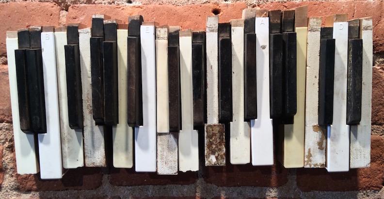 B -E - A - D, 2015 found & altered piano key parts, pine, oak, hardware. Collection of Margo Casstevens & Kurt Madison.