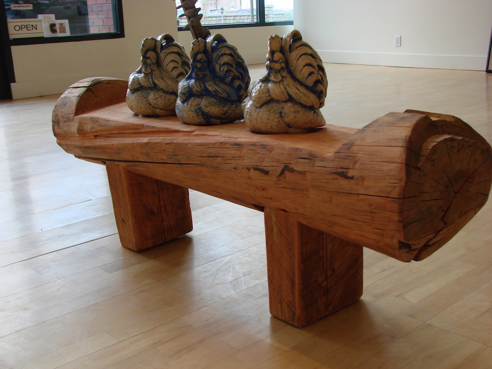 The Critics, cedar slabs, pine log, ceramic, mason stains.  2008   Collection of the Spokesman Review