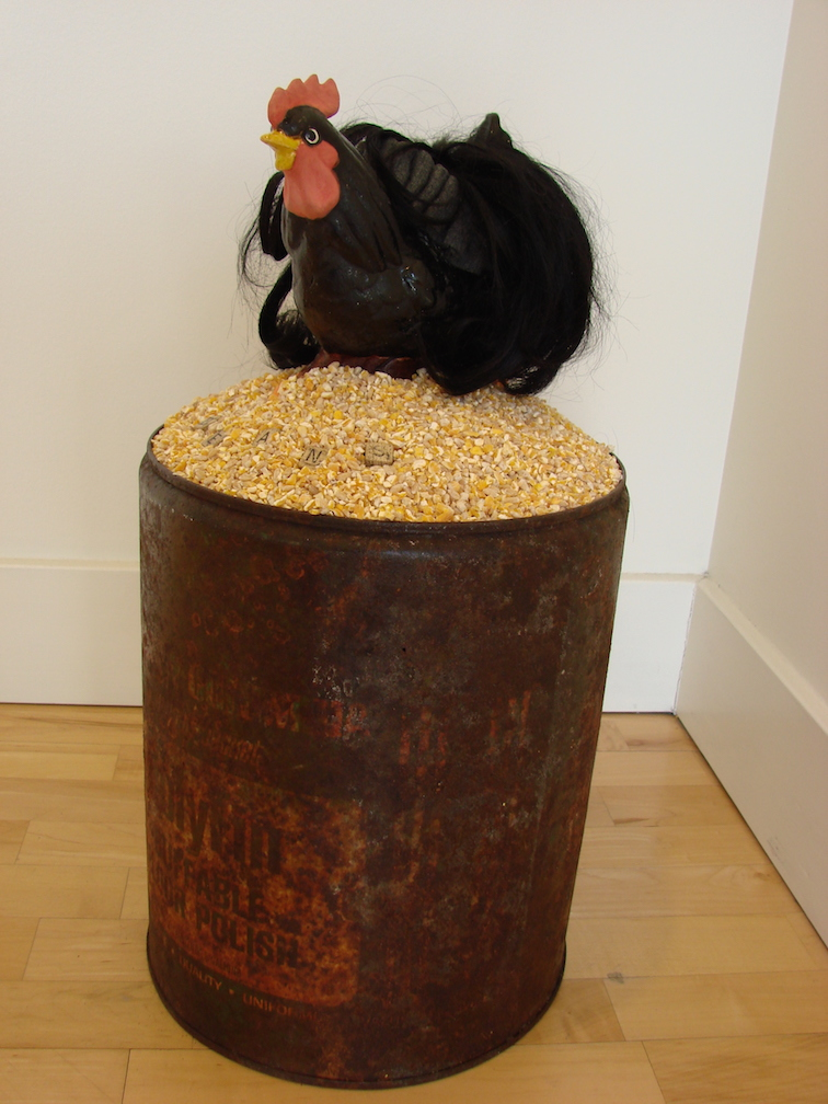 Self Portrait as a Cock, found objects, chicken scratch, ceramic, the artists hair. 2008