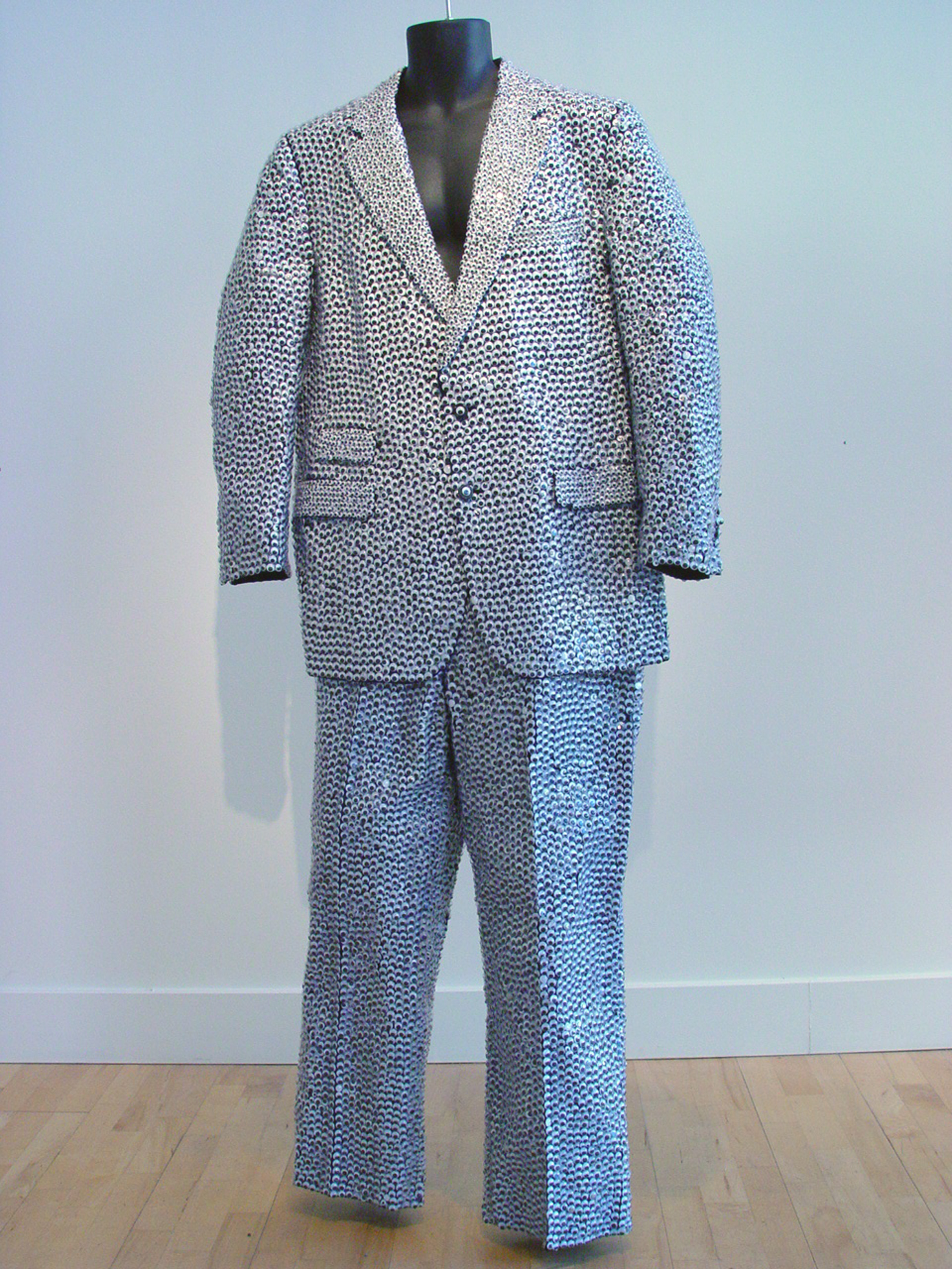 Garment for the Perpetually Insecure.  Wool blend mens suit, adhesive, wiggle eyes.