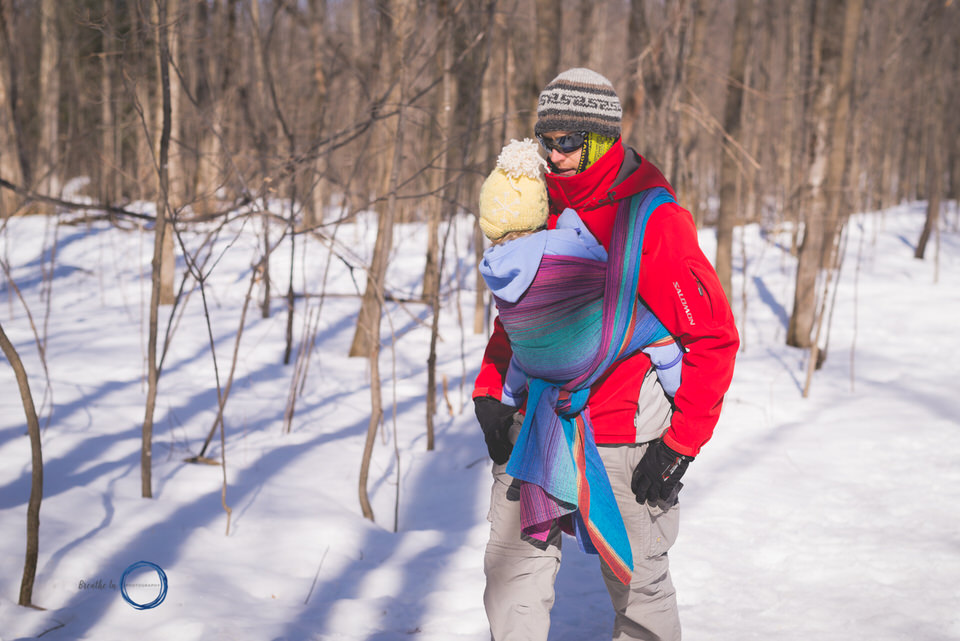 Dad and daughter winter babywearing on hike in Gatineau.