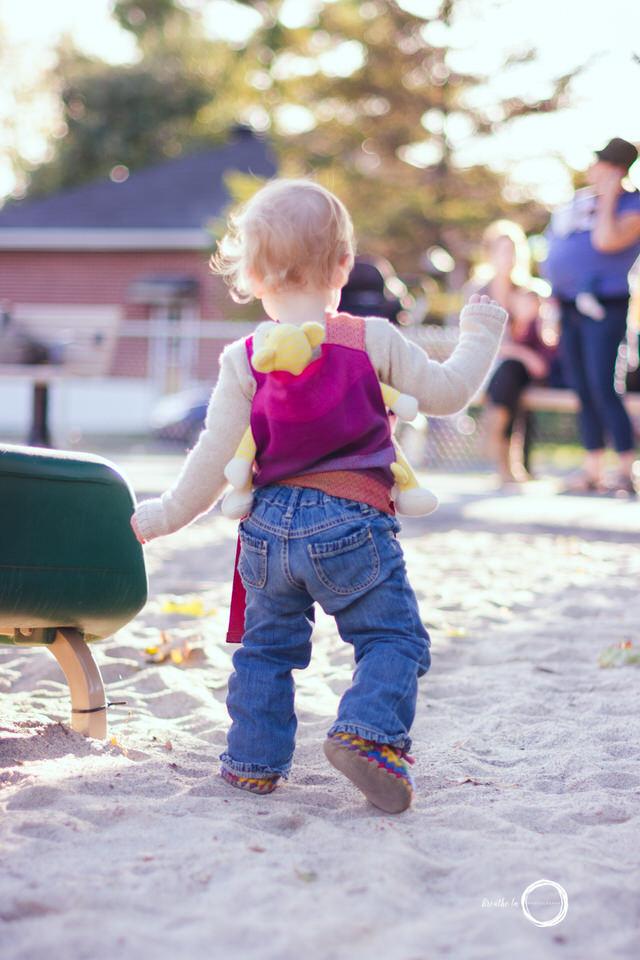 Babywearing Toddler in Ottawa Park in Vanier walking through the sand.
