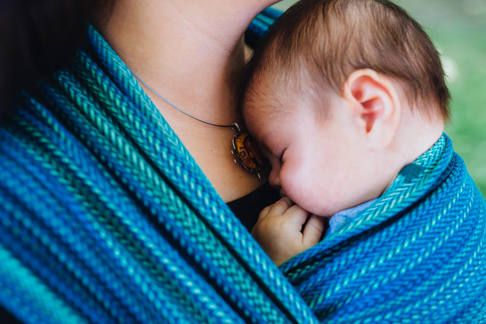 Newborn babywearing in Seawater blue handwoven wrap
