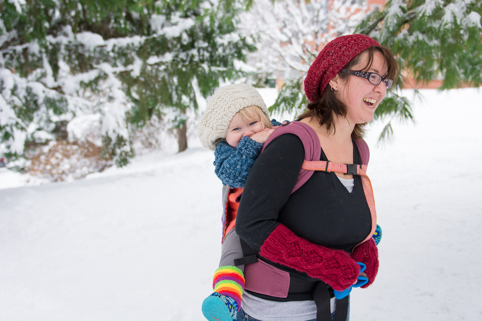 Girl in Bamberoo Carrier in snow at Vanier Park