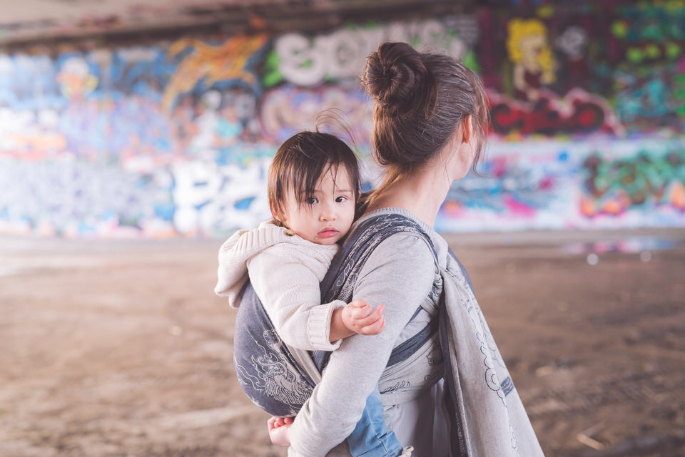 Grafitti wall babywearing in Oscha Zen wrap Ottawa
