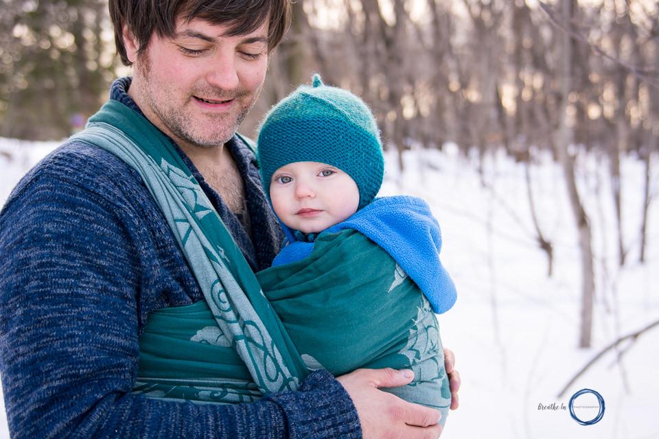Dad carrying his son in Natibaby Wool Wrap at Vanier Sugar Bush.